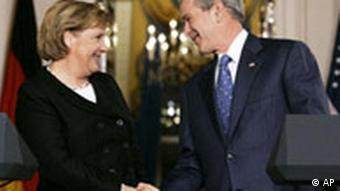 US President George Bush shaking hands with German Chancellor Angela Merkel