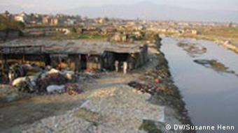 A polluted stream on the edge of a settlement in Nepal