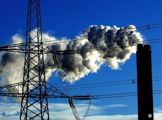 A chimney stack belches smoke into the air from a coal fired power station