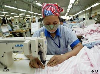 A female worker works on shirts to be exported to the United States at Garment Company 10 outside Hanoi, Vietnam