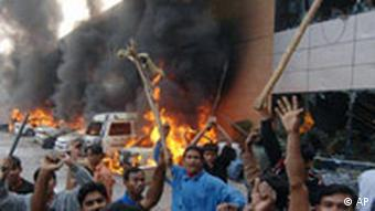 Dhaka, 2007: protests by garment workers regularly turn violent