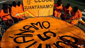 Members of Amnesty International wearing Guantanamo-style orange inmate outfits at a protest