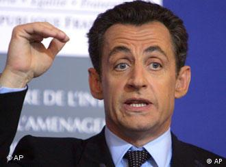 French Interior Minister Nicolas Sarkozy gestures as he addresses the media during a press conference held in Paris, Thursday Jan. 11, 2007. Presidential hopeful and Interior Minister Nicolas Sarkozy trumpeted his crime-fighting record Thursday, hoping to convert a drop in crime into an advantage in his campaign for the presidency. (AP Photo/Remy de la Mauviniere)