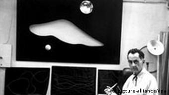 Man Ray in his studio in 1950