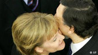 German Chancellor Angela Merkel kisses President of the European Commission Jose Manuel Barroso