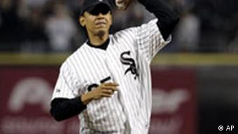 Obama, throws out the cermonial first pitch a baseball game