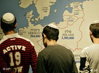 Jewish students look at a map showing the numbers of Jews living in European countries before World War II, on display at the Yad Vashem Holocaust Memorial in Jerusalem,Thursday, Jan. 27, 2005 on the 60th anniversary of the liberation of the Auschwitz death camp. (AP Photo/Oded Balilty)