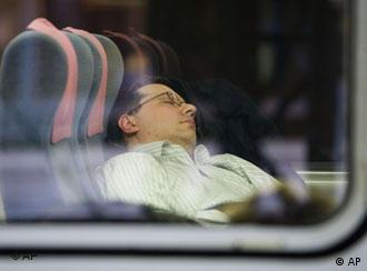 A man sleeping on a train