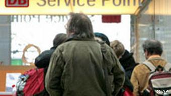 Man standing in line at a DB Service Point