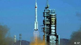 China's first manned spacecraft Shenzhou 5 lifts off at the Jiuquan Satellite Launch Center in northwest China's Gansu Province Wednesday, Oct. 15, 2003. China launched its first manned space mission on Wednesday, sending an astronaut hurtling toward orbit and becoming the third country in Earth's history to do so, four decades after the Soviet Union and the United Sates. (AP Photo/Xinhua, Li Gang)