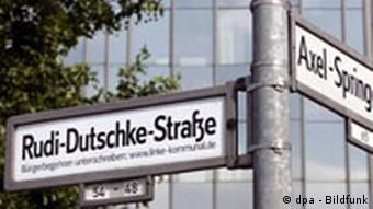 A sticker pasted over a Berlin street sign, proposing to call it Rudi Dutschke Street