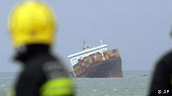 Rescue crews look at a listing ship