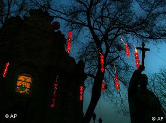 Traditional Chinese lanterns light decorate the entrance to the Southern cathedral in Beijing, China Tuesday Jan. 23, 2007. China's state-backed Catholic church welcomed a newly announced Vatican initiative to repair ruptured relations with Beijing and said a promised letter from the pope to Chinese Catholics could be helpful. The diplomatic initiative comes as China is experiencing a religious boom while the Vatican remains hobbled by a half-century-long dispute with Beijing. A communist government-backed Catholic church refuses to recognize the Vatican's authority while many clergy and ordinary Catholics remain loyal to the pope and have been persecuted for it. (AP Photo/Elizabeth Dalziel)