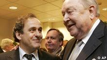 UEFA chief Lennart Johansson, right, and former French soccer great Michel Platini, who is also member of the FIFA executive commitee, talk after a ceremony at the French soccer federation headquarters in Paris, Thusrday, Jan. 11, 2007. The French soccer federation inaugurated a new office in the heart of Paris on Thursday. Platini is hoping to replace Johansson as European soccer president later this month, in an election that will take place Jan. 25-26 at the UEFA Congress in Duesseldorf, Germany. (AP Photo/Christophe Ena)