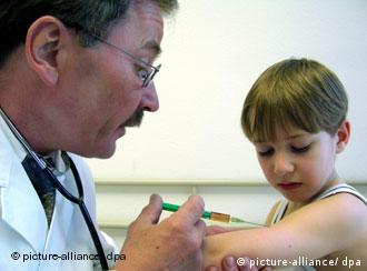 A doctor gives a child an injection in the arm