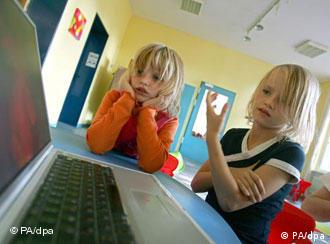 Two young children at a computer