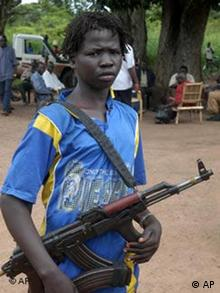 An armed child-soldier in Sudan