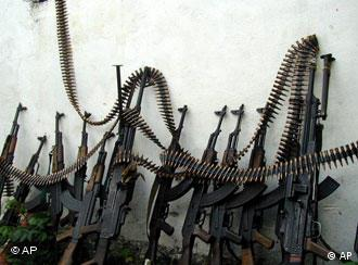 Kalashnikov assault rifles and a couple of heavy machine guns are lines up against a wall at one of Mogadishu four open-air markets, Monday, July 9, 2001. As the United Nations discusses what to do about the world's illegal small arms trade, it is business as usual at the gun markets for traders who supply arms to eastern and central Africa. Somalia became a magnet for small arms and munitions after President Mohamed Siad Barre was ousted by clan-based faction leaders in January 1991. (AP Photo/Osman Hassan)