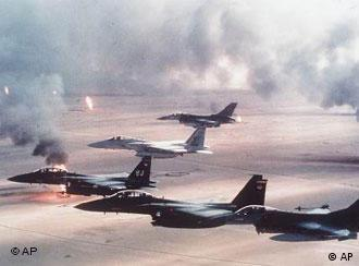 US war palnes fly over burning oil wells in Kuwait after Desert Storm.