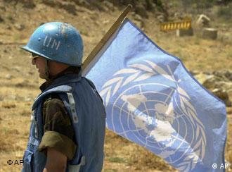 UN peacekeeper holds flag