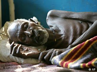 A malnourished African man lying down