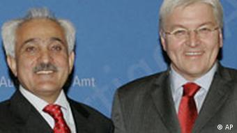 Spanta and Steinmeier, smiling
