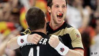 * RETRANSMISSION OF MME118 TO PROVIDE ALTERNATE CROP * Germany's Torsten Jansen, right, wearing a gumshield in the national colors celebrates with Christian Schwarzer after winning the Handball World Championships quarter final match between Spain and Germany in Cologne, Germany, Tuesday, Jan. 30, 2007. Germany defeated Spain 27-25 and advanced to the semi finals. (AP Photo/Martin Meissner)