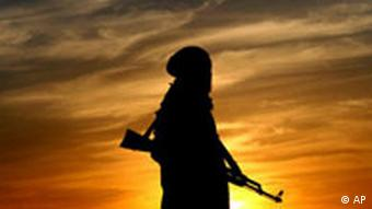 Silhouette of Afghan soldier at dawn