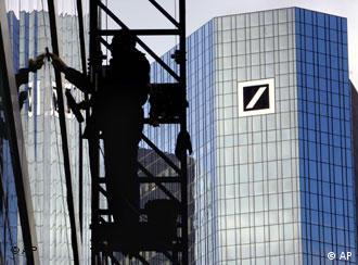 A man cleans windows at Deutsche Bank's headquarters in Frankfurt