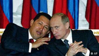 Russian President Vladimir Putin, right, and Venezuelan President Hugo Chavez talk during their meeting in Moscow's Kremlin on Friday, Nov. 26, 2004. Chavez and Putin were set Friday to discuss energy cooperation between their countries, two of the world's largest oil suppliers, and military trade, Russian news agencies reported. (AP Photo/ Mikhail Metzel )