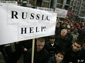 Kosovo Serbs hold a sign asking Russia for help