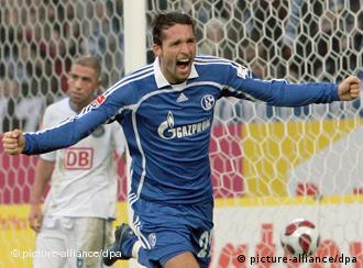 German soccer player Kevin Kuranyi cheers after scoring a goal