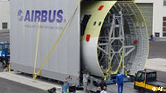 Workers of Airbus loading the first fuselage sections for an airplane