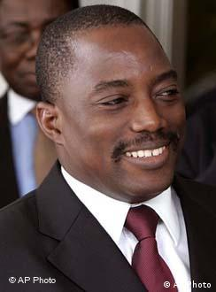 kabila.jpg **FILE** President Joseph Kabila smiles during a meeting with former heads of state in Kinshasa, Congo in this Saturday, Nov. 4, 2006 file photo. Kabila appeared to have an insurmountable lead Tuesday, Nov. 14, 2006, in Congo's runoff election with nearly all the votes counted. (AP Photo/Schalk van Zuydam, FILE)