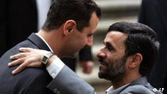 Iranian President Mahmoud Ahmadinejad, right, welcomes his Syrian counterpart Bashar Assad