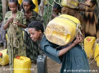 A girl in the village of Mendefera transports drinking water in a yellow canister