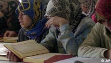 Young girls recite from Islam's Holy Book, the Koran during a female-only religious instruction course at Sevket Basak mosque in southeastern Batman city on Fiday, Oct. 26, 2000, where women are also instructed that suicide is sin in Islam. Suicide rate among women in southeast Turkey, the most traditional part of the country, is skyrocketing, as many see killing themselves as the only way out of deep socio-economic problems, including poverty, forced marriages and family repression. (AP Photo/Burhan Ozbilici)