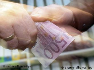 A 500-euro bill is passed off in a symbolic picture of a bribe being paid