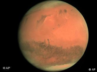 This image released by the European Space Agency ESA on Sunday Feb. 25, 2007 shows a two-colour composite of Mars seen by ESA Rosetta probe's Osiris narrow-angle camera on Feb. 24, 2007 from a distance of about 240,000 kms.