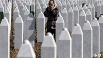A man prays at the memorial to those killed at Srebrenica