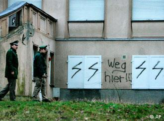 Police inspect anti-Jewish graffiti on the walls of the nursery in Berlin