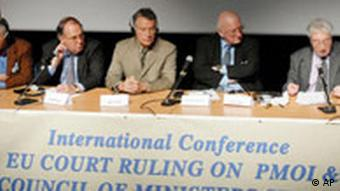 Former Solicitor-General of the United Kingdom Lord Archer of Sandwell, right, addresses a press conference in Brussels, Thursday March 1, 2007, to announce the response of the People's Mojahedin of Iran (PMOI) to the European Union Council of Ministers in protest to keeping the PMOI on EU terror list.