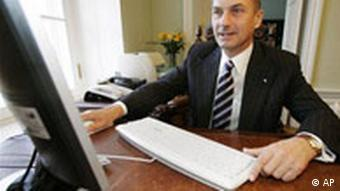 Estonian Prime Minister Andrus Ansip votes online during this year's election
