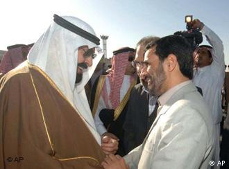 Iranian President Mahmoud Ahmadinejad, center-right, is greeted by Saudi Arabia's King Abdullah