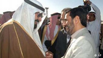 Iranian President Mahmoud Ahmadinejad, center-right, is greeted by Saudi Arabia's King Abdullah