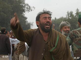 A man cries after a suicide attack killed several people
