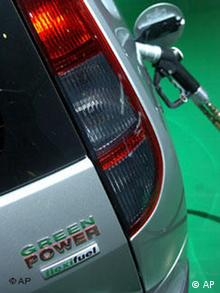 Green power: car being fueled with alternative gas
