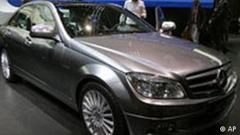 Mecedes-Benz' new C 220 bluetec limousine is seen after being unveiled onthe first press preview day at the 77th Geneva International Motor Show, in Geneva, Switzerland, on Tuesday, March 6, 2007. The Motor Show will open its gates to public from March 8 to 18, 2007 with more than 250 exhibitors presenting more than 80 World and European premiers. (AP Photo/Nicholas Ratzenboeck)