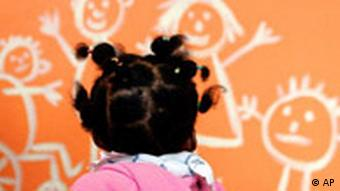 A young girl looks at a picture on a wall in a Kindergarten in Bremen