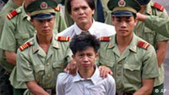 Chinese police take a resident to hear the public announcement of his death sentence for a drug crime